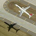 Airplane - Northwest Airlines Jet Taking Off (Birds Eye)