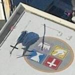 Helicopter on Roof with Foursquare Church Logo