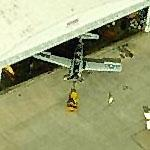 Classic warbird towed from hangar at Wiley Post Airport (Birds Eye)