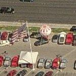 Big balloon at a car lot (Birds Eye)