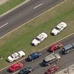 Police cars in the median