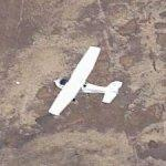 Small plane in flight (Birds Eye)