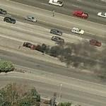 Burning car on highway (Birds Eye)