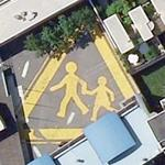 Children crossing huge sign. (Bing Maps)