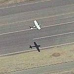 Airplane Taking Off From Cable Airport (Birds Eye)