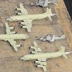 A-6 Intruder, 2 EA-6B Prowlers, and 8 green P-3 Orions (Birds Eye)