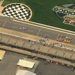 Stock cars on Michigan Speedway pit lane