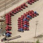 Tractors waiting to hit the railroad (Birds Eye)