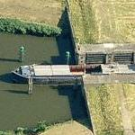 Barge transiting a lock