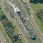 Barge moving in a large lock (Birds Eye)