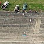 People flying model airplanes (Birds Eye)