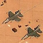 F-16s armed with missiles and fuel tanks (Birds Eye)