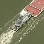 Tug pushing barges